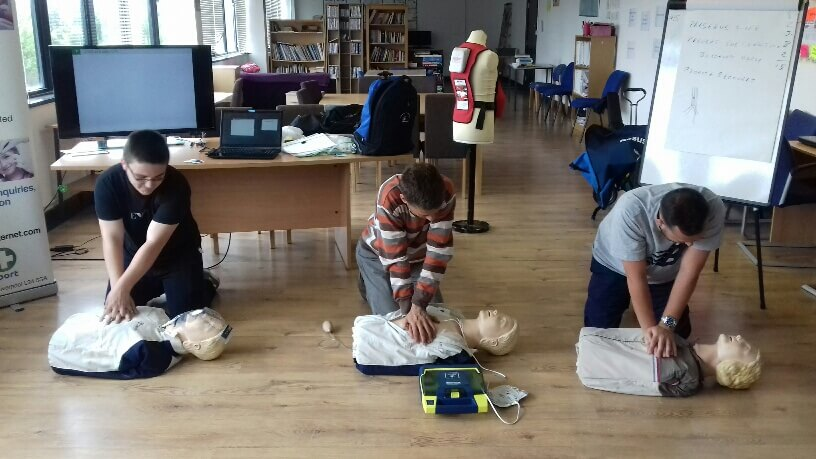 First Aid delivering CPR and using a Defibrillator